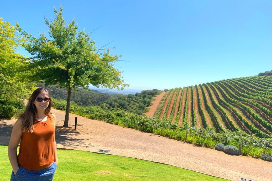 Girl standing in vineyard at Tokara in Stellenbosch, South Africa