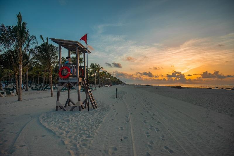 Winter sun destinations, sunset at playa del carmen beach, mexico